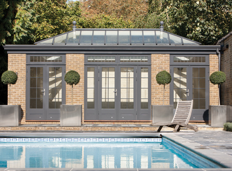 Outside Swimming Pool With Pool House To One Side