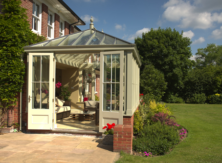 End view of garden room with pitched glazed roof with view into living area