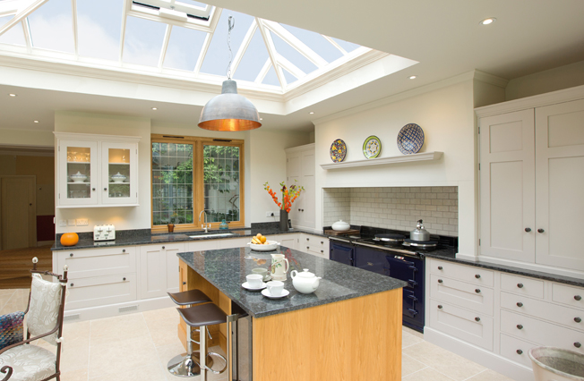 Contemporary kitchen extension with roof lantern and wooden base island