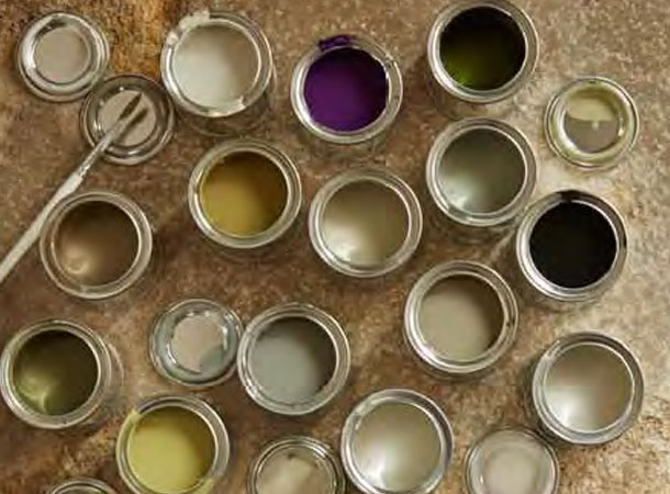 Paint pots in the extensive workshops where Westbury garden rooms, orangeries and roof lanterns are made