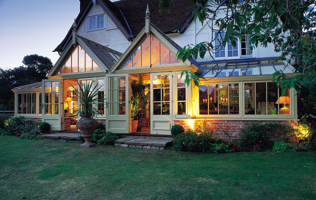 Beautiful conservatory featuring two gables defining access to garden area