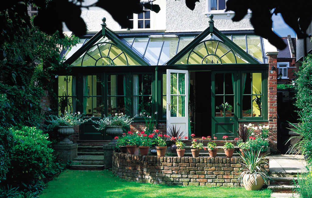 Gorgeous lean-to style conservatory featuring two matching gables defining access to garden