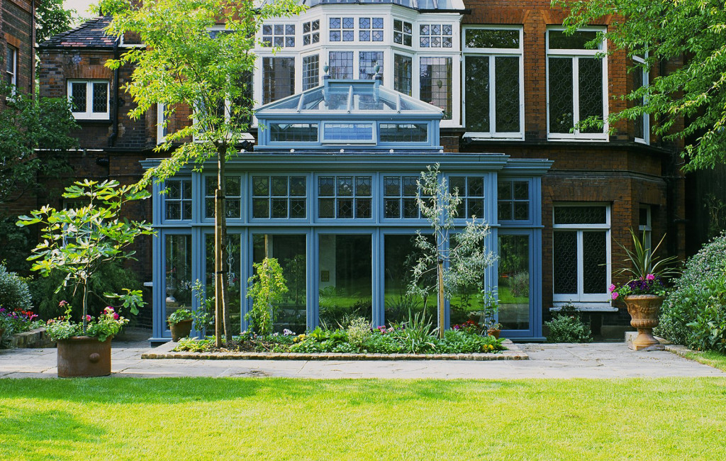 A contemporary take on a traditional theme conservatory featuring glass that almost touches the floor
