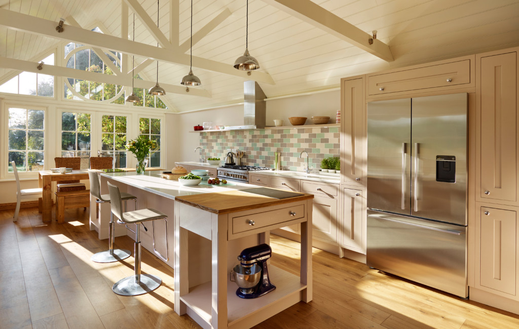 Beautiful kitchen room with central island and featuring a glazed gable elevation
