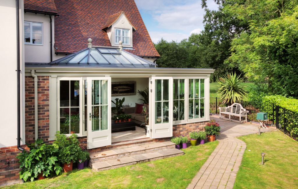 Impressive orangery featuring french doors to a spectacular garden