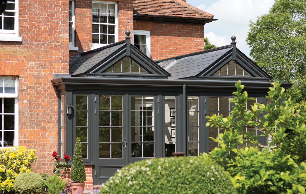 Garden room featuring twin gable ends and a tiles roof