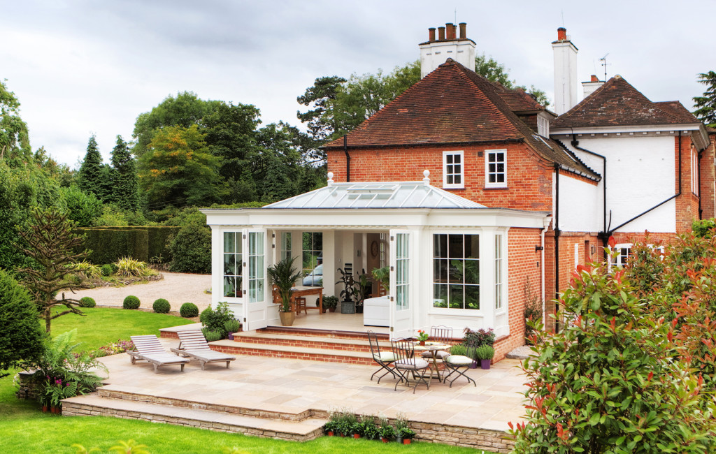 Classic example of an orangery with a contemporary twist that allowing wide access to garden