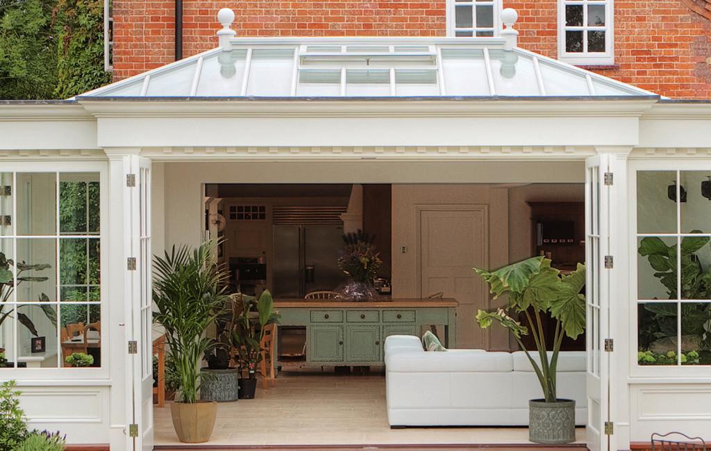 Kitchen room sat perfectly within a westbury orangery providing views into garden