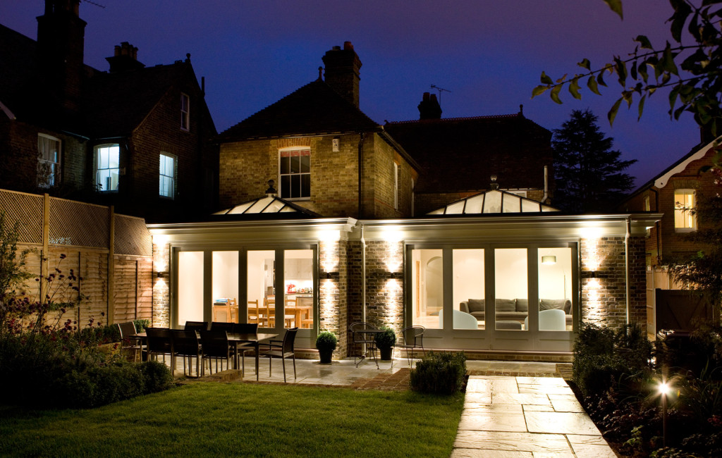 Contemporary orangery featuring 2no. pyramid lanterns defining sitting and dining areas