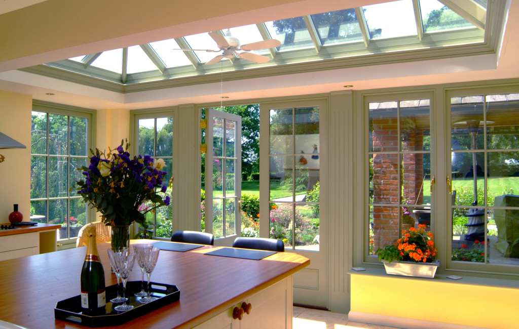 Beautiful kitchen room with central island and roof lantern above