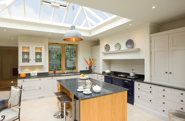 Large light and airy kitchen extension with roof lantern above island