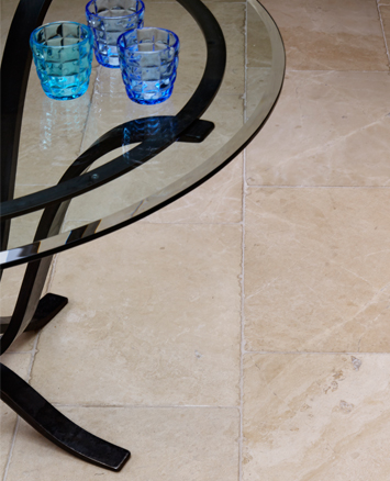 Glass table and stone flooring in garden room