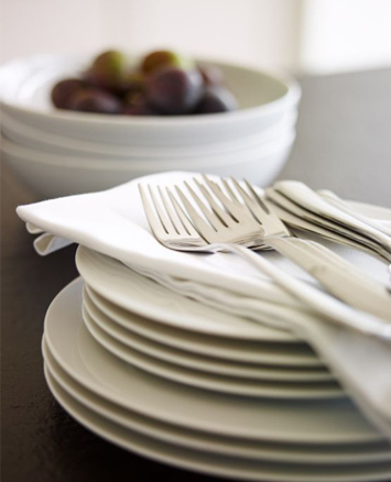 Cutlery and crockery ready for entertaining in an extension