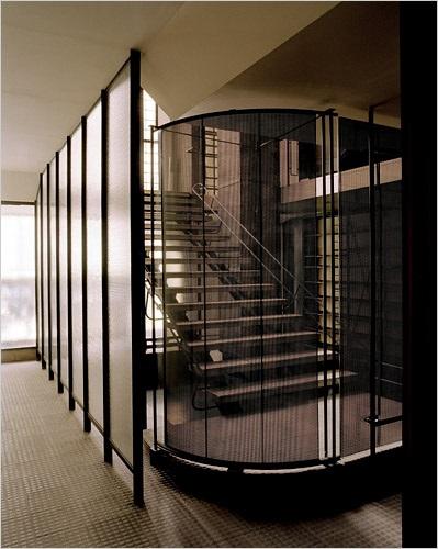 Staircase with sliding door in maison de verre