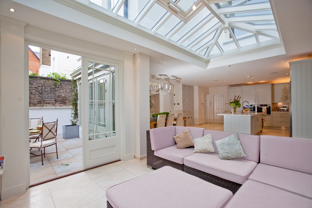 Pantone pink sofa in a Westbury garden room