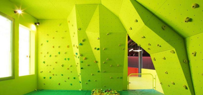 Lime green climbing wall inside sports centre