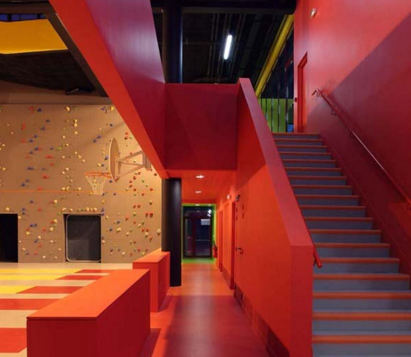 Inside of sports centre with red stairway
