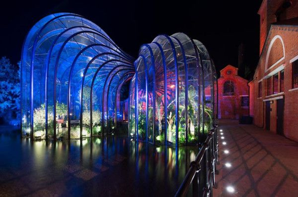 The Bombay Sapphire Distillery glazed building lit up at night