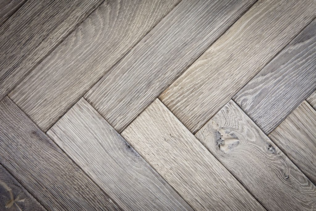 Close up of grey herringbone wooden flooring