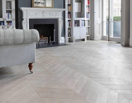 Grey herringbone flooring in a light and airy room