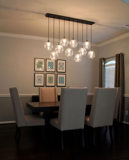 Dining table with pendant lighting hanging over