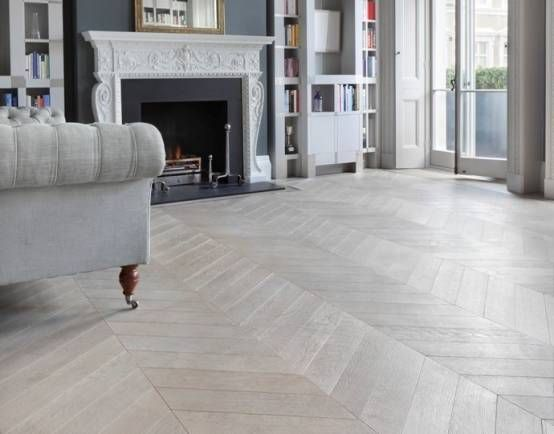 Grey herringbone flooring in a light and airy room