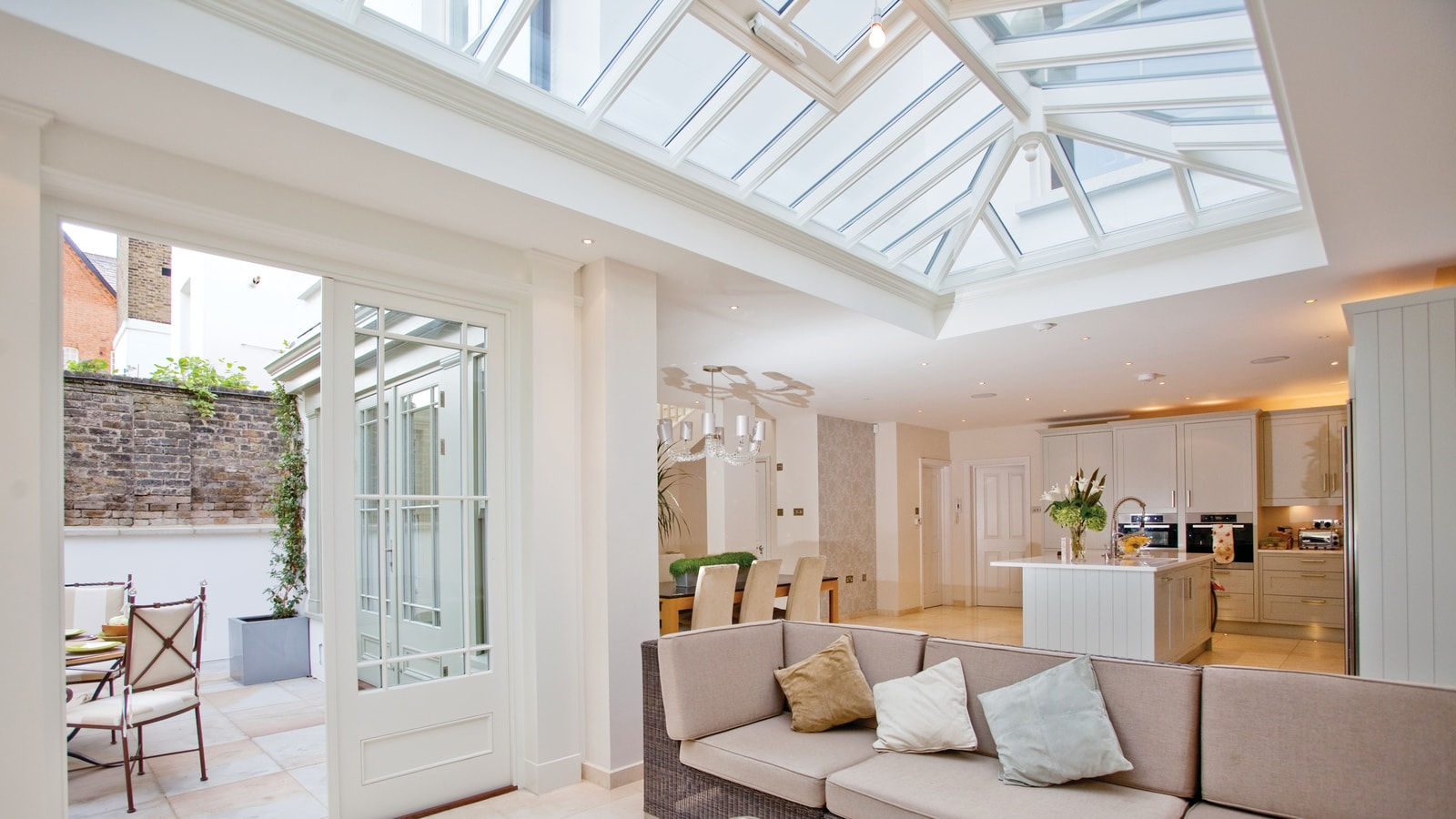 Stylish orangery with large roof lantern, used as spacious seating area