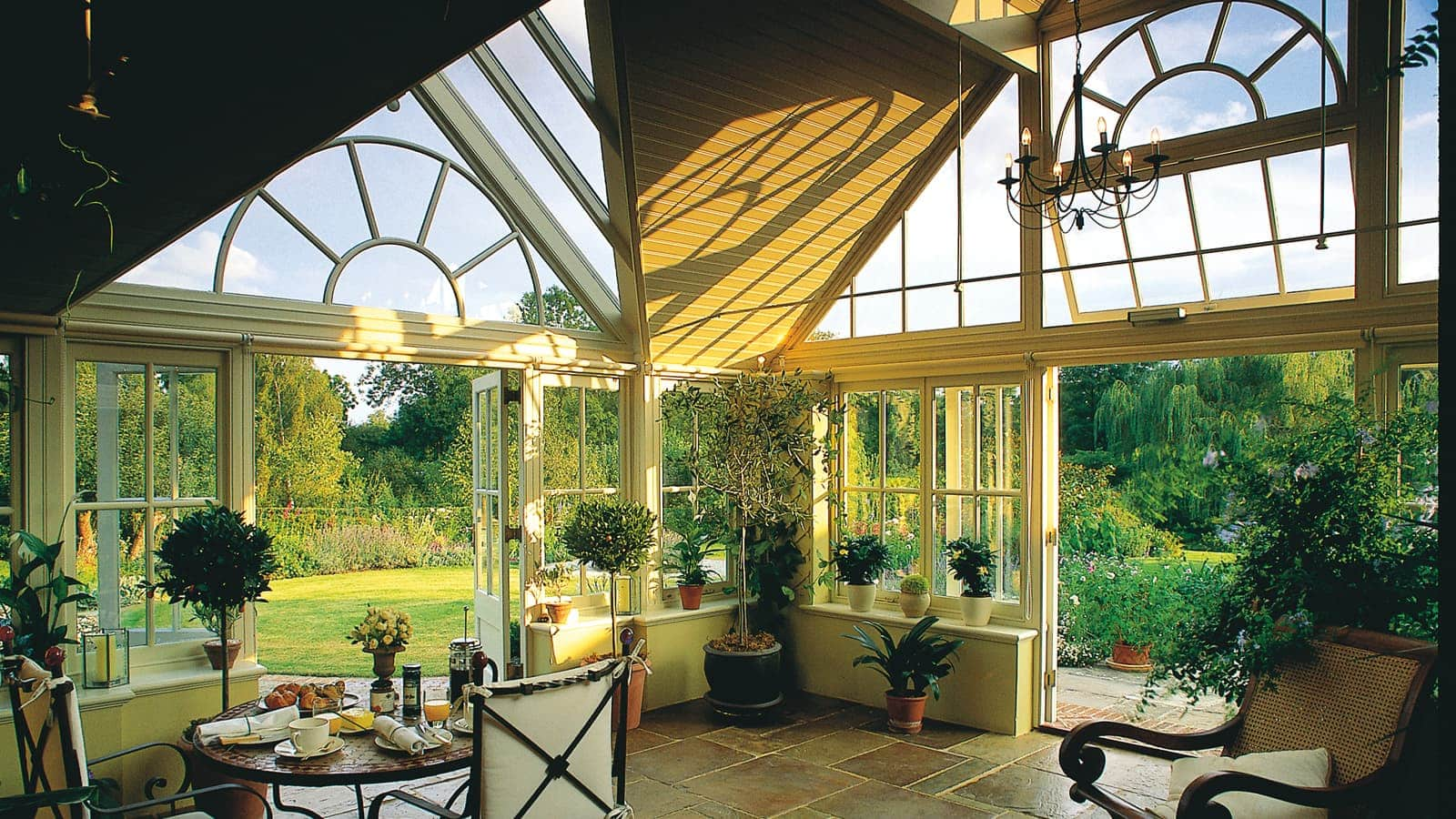 Garden room featuring gable ends overlooking an English garden