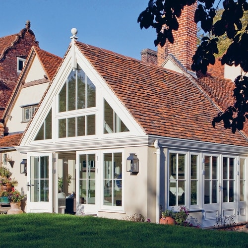 External shot of Garden Room Extension large glazed gable with peg tile roof