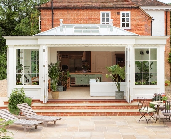 Orangery with deep fascias and dentil blocking used to mimic the house's own eaves