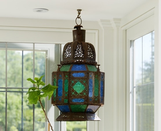 Blue and green coloured hanging lantern