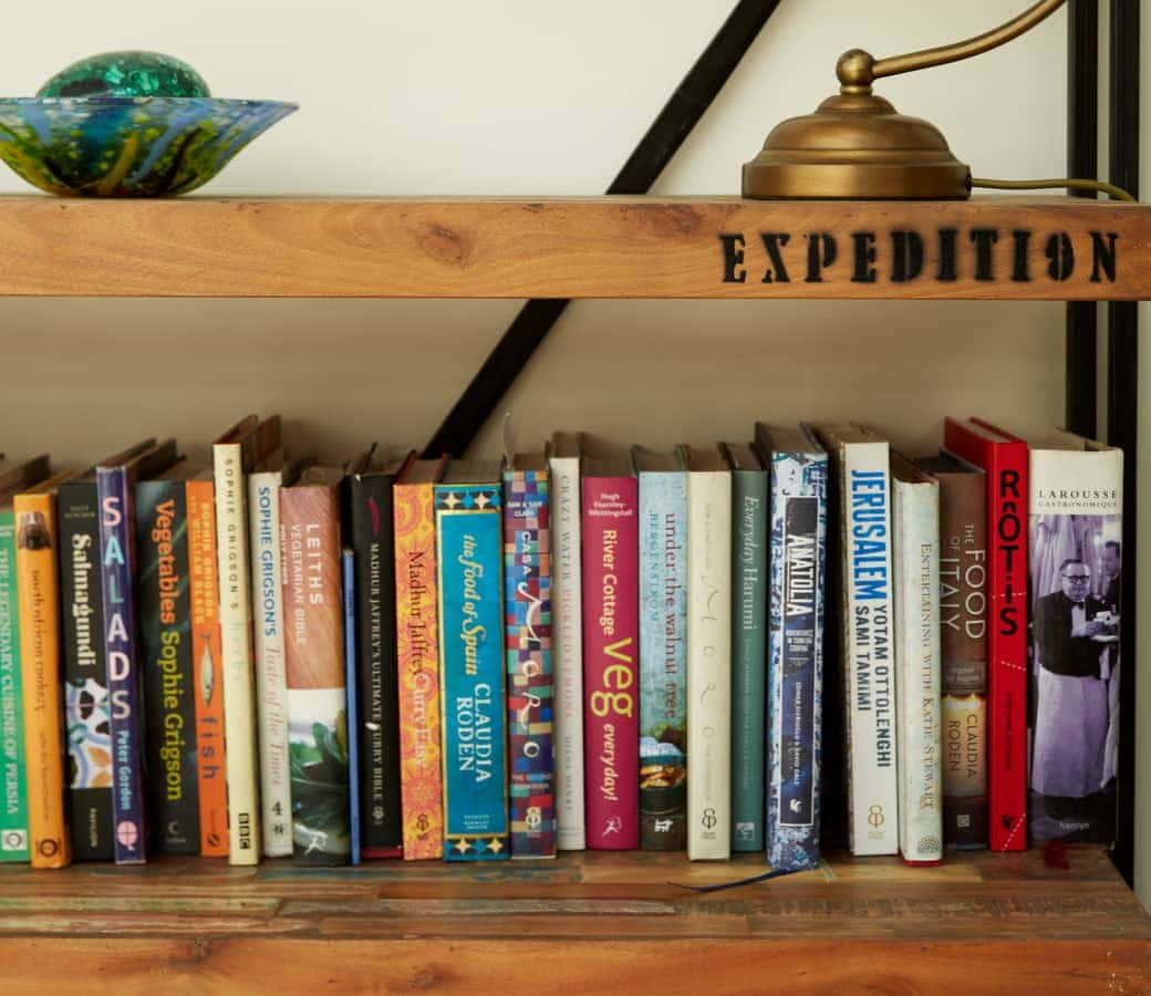 Selection of books on a wooden bookshelf