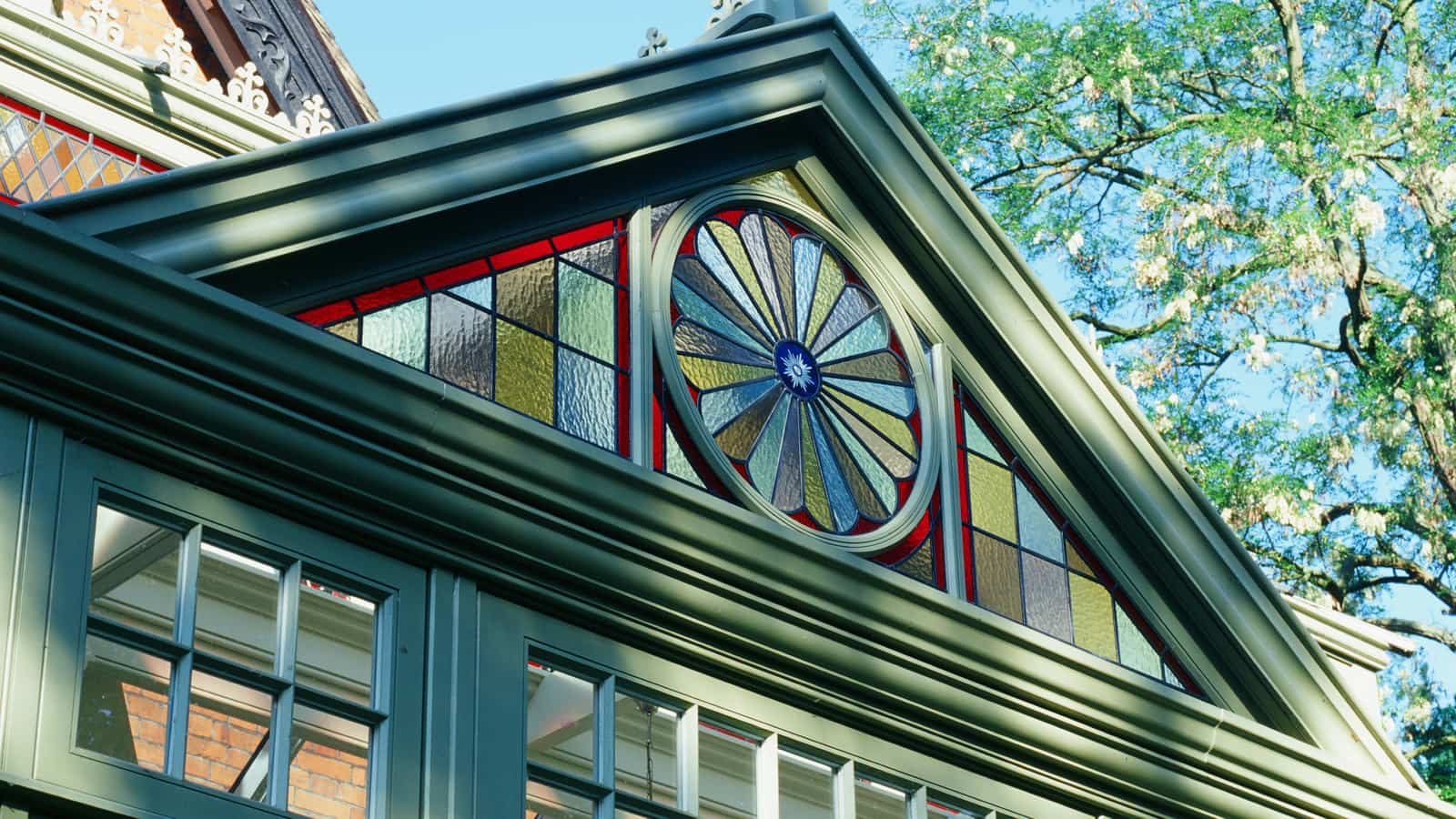 Coloured glazed gable on traditional conservatory