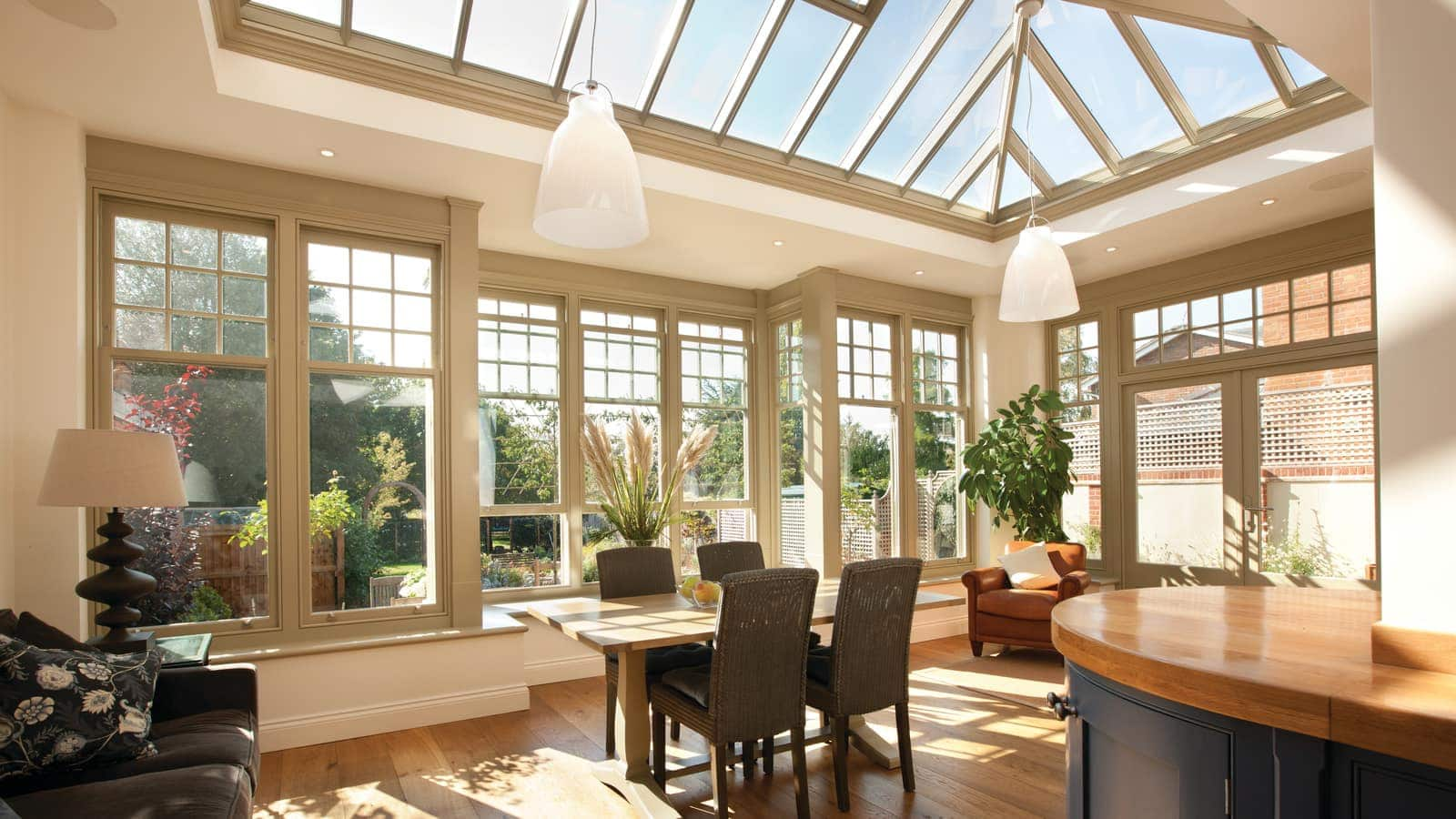 Dining and sitting area in new orangery, with large roof lantern