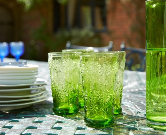 Close up of green glasses on a table in a garden