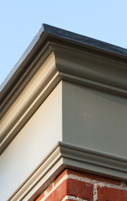 Close up on entablature finished in Portlane Stone colour