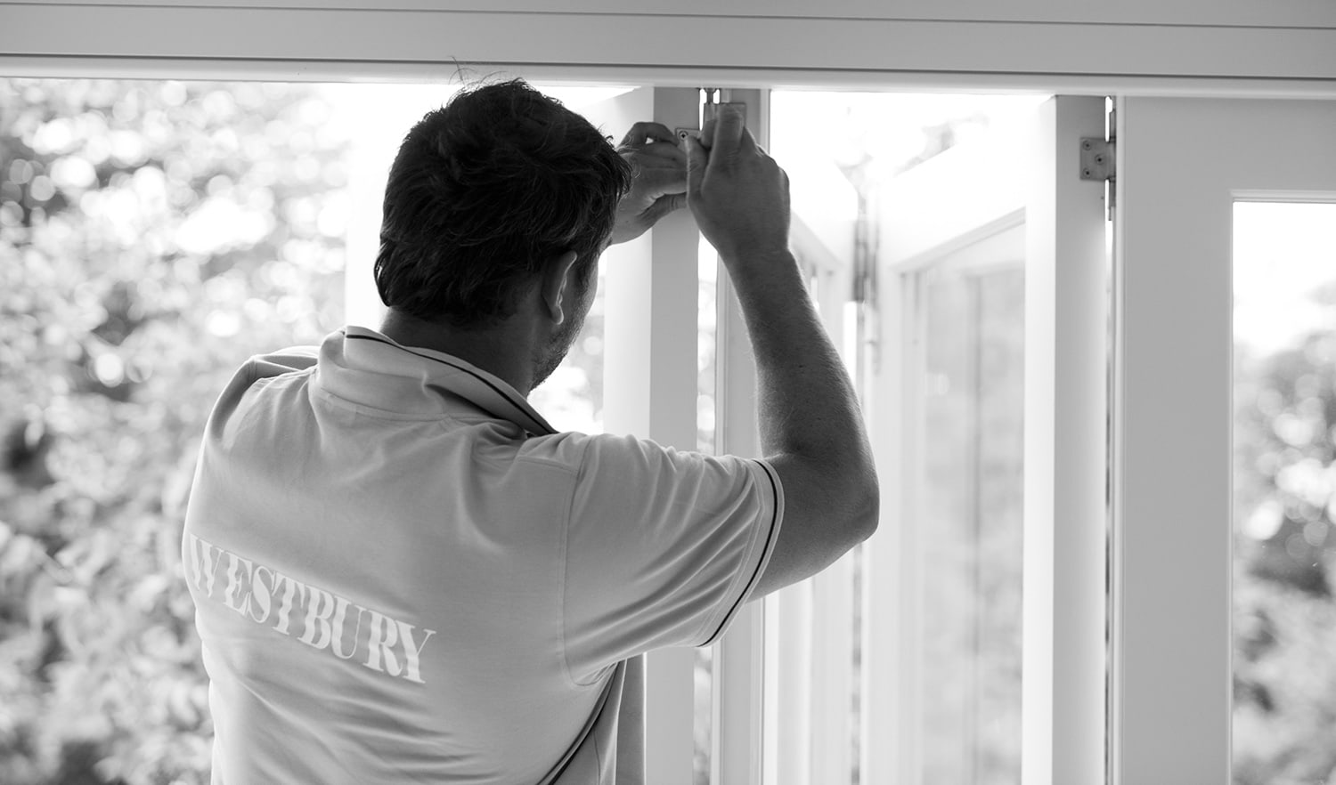 Westbury staff member securing a door hinge