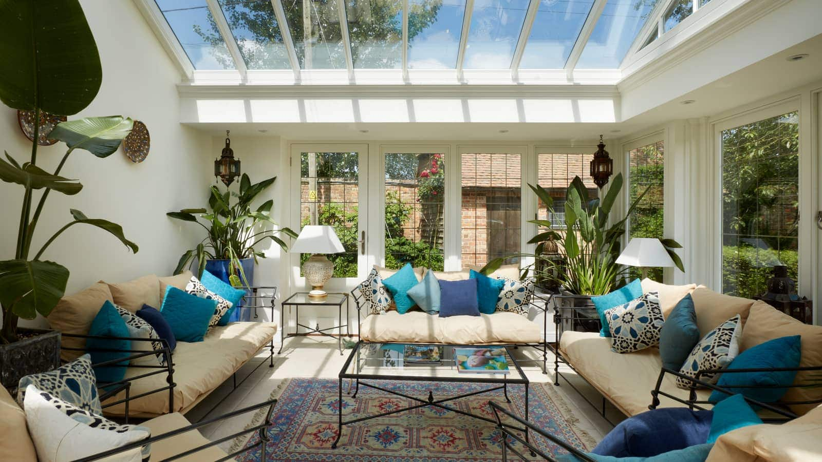 Garden room sitting room, designed with a lead roof and parapet, and twin lanterns