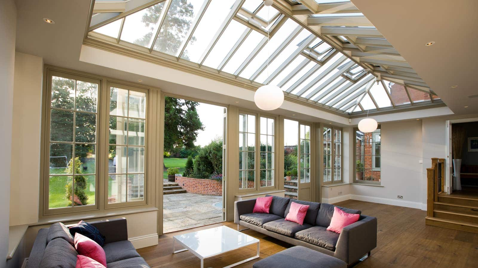 Interior shot of lounge area inside orangery extension with large timber roof lantern