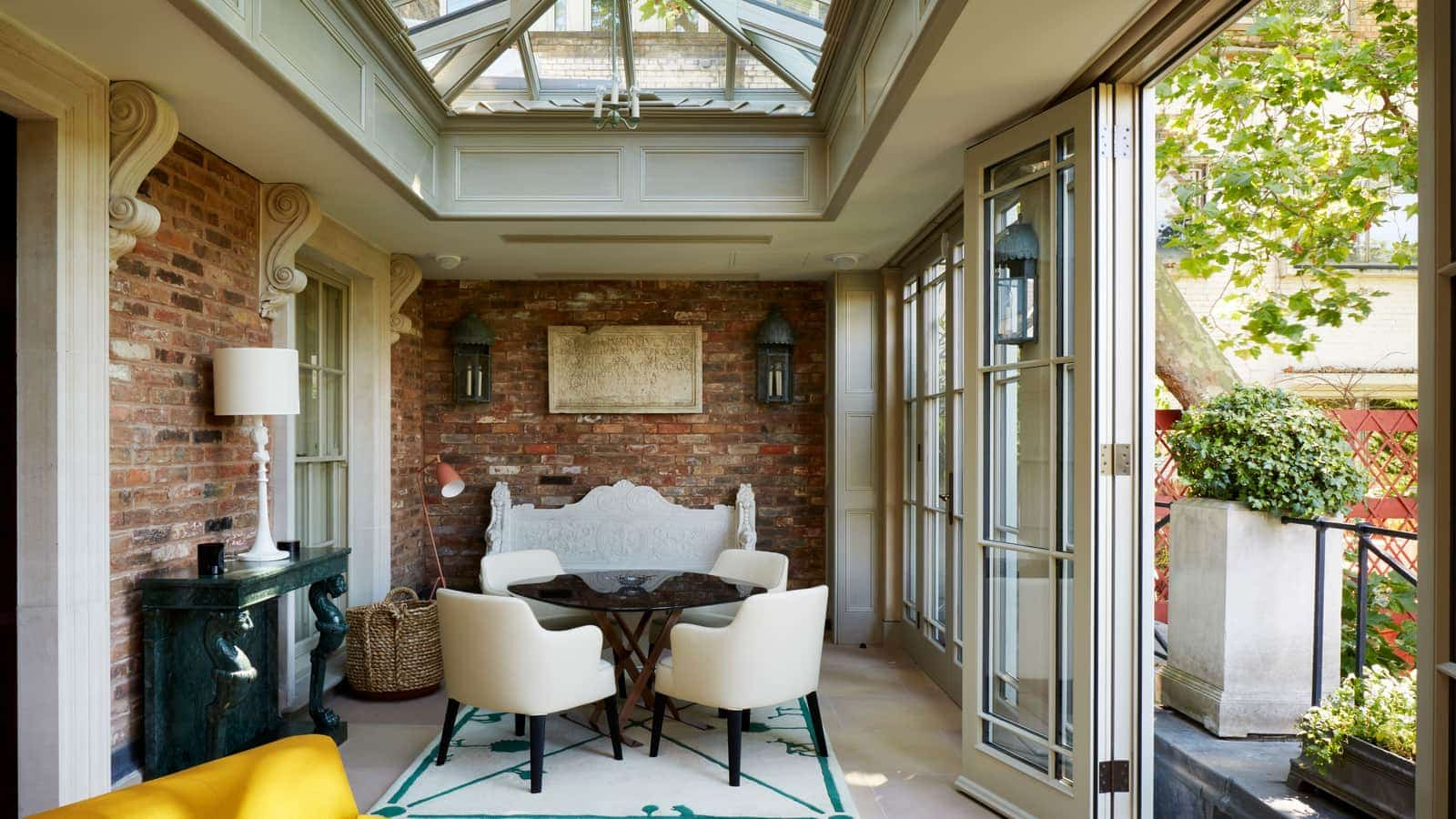 Interior view of orangery with french doors, roof lantern and exposed brick work