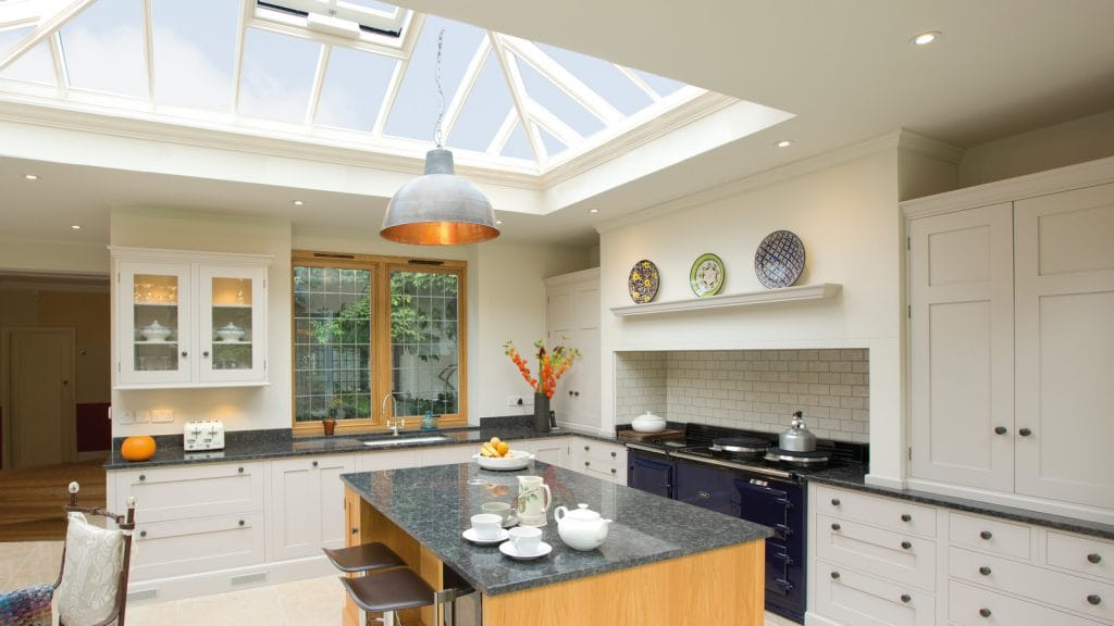 Modern kitchen room interior with large kitchen island and roof lantern
