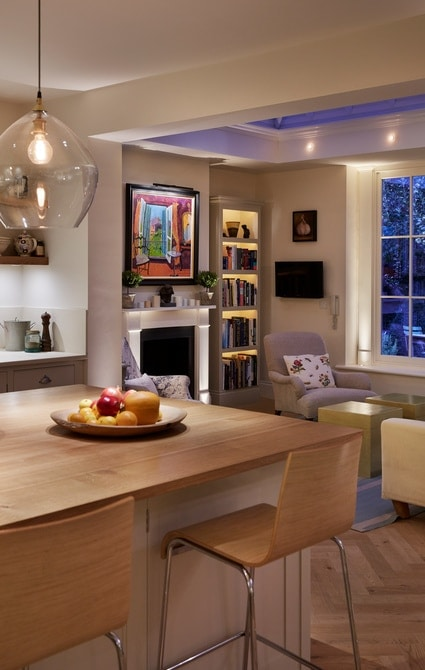 Kitchen seating area overlooking lounge room