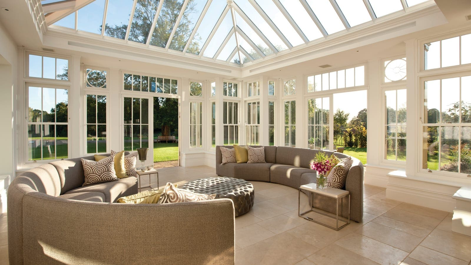 Large open living space inside newly built orangery, finished with stone floor