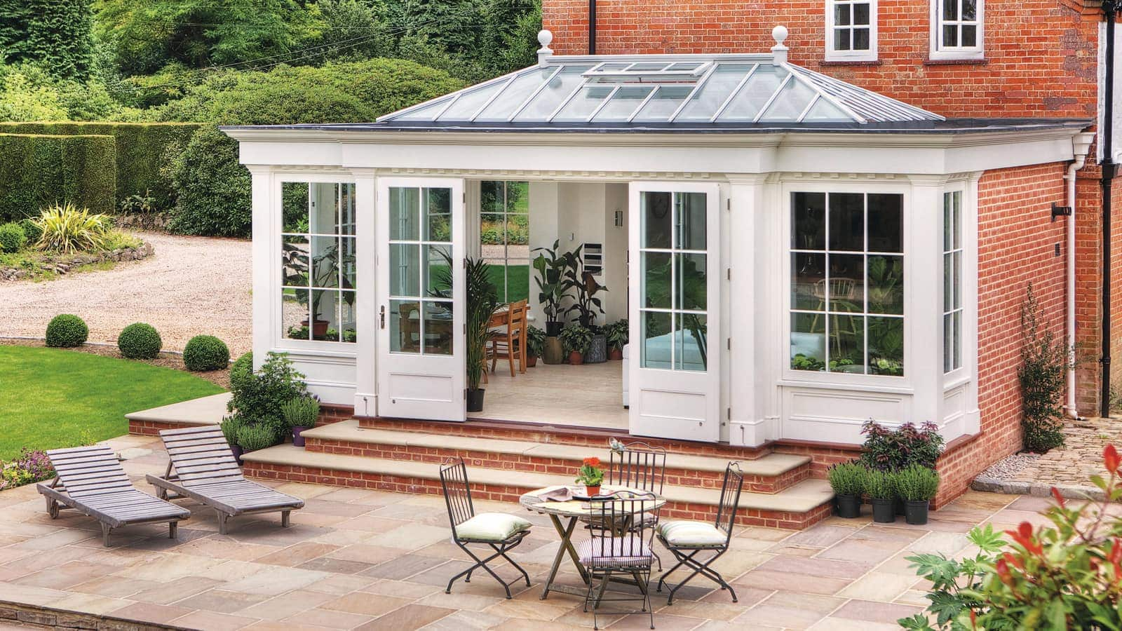 Classic orangery with a modern twist, allowing wide access to garden
