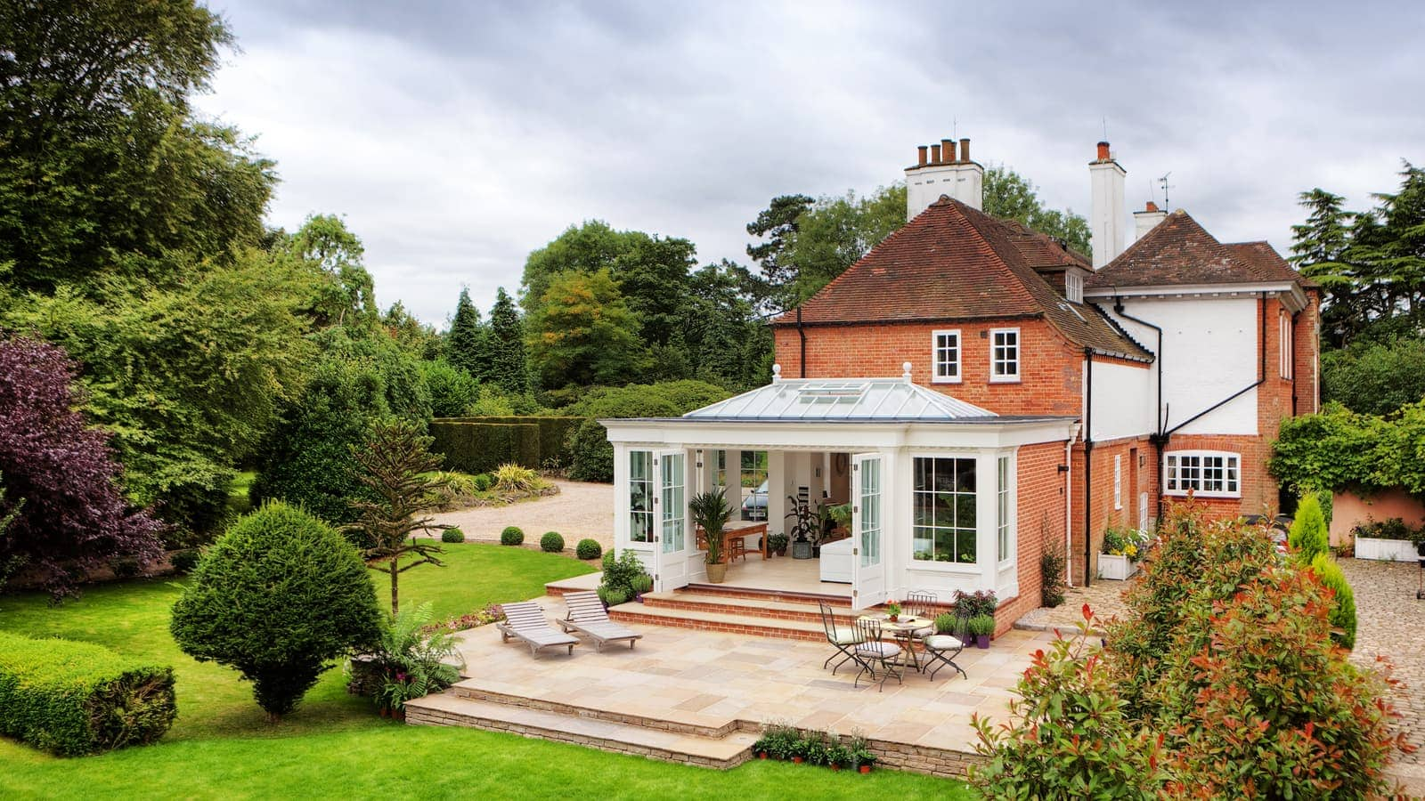 Orangery extension with double folding stacking doors overlooking stunning garden
