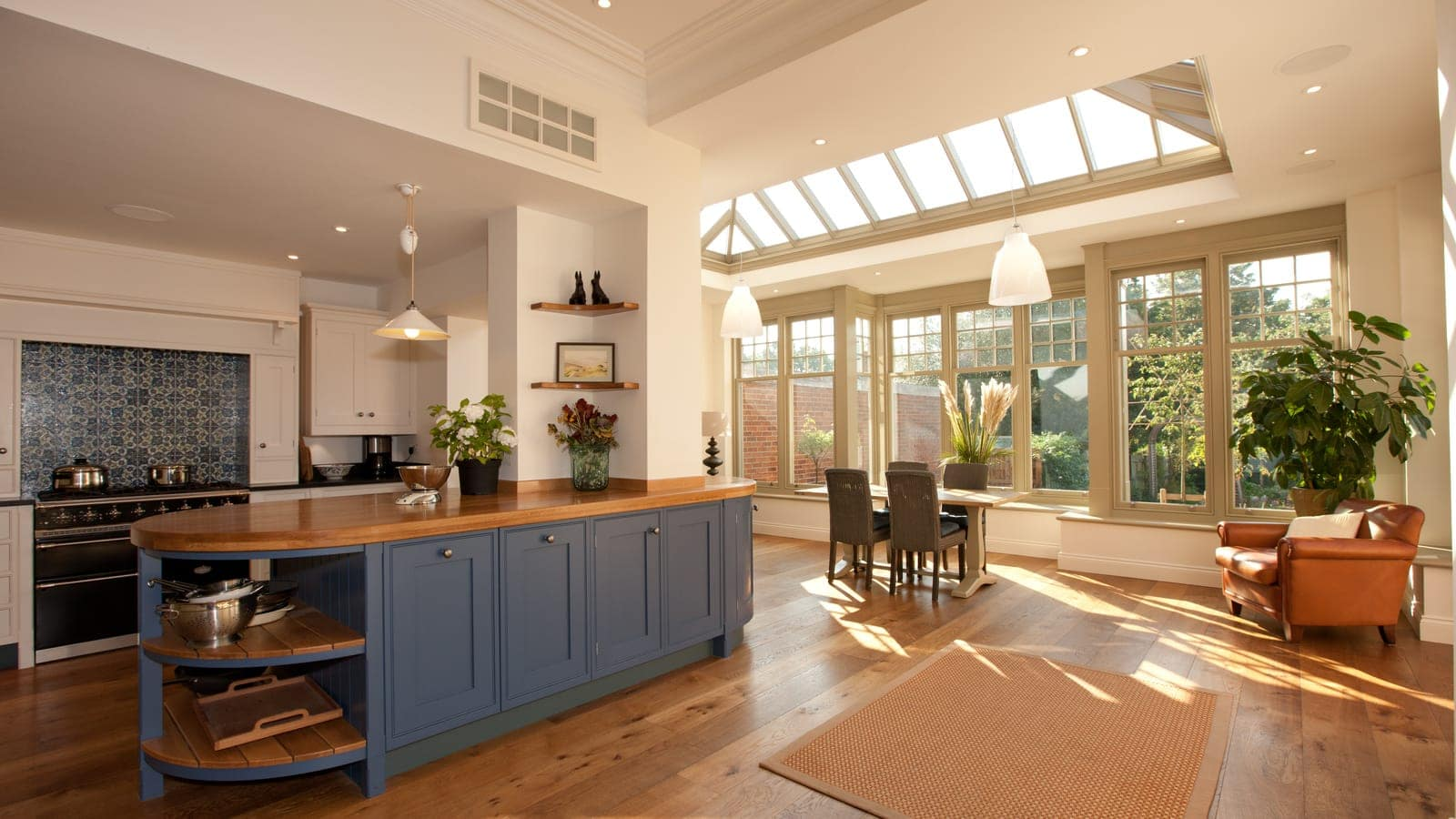 Open plan kitchen and dining area inside large orangery