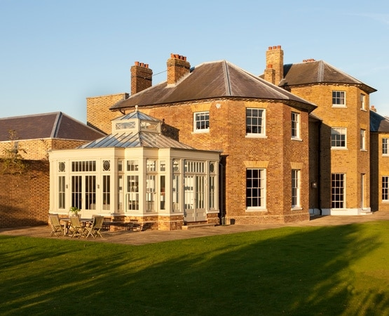 Striking orangery built at the rear of a beautiful mansion house