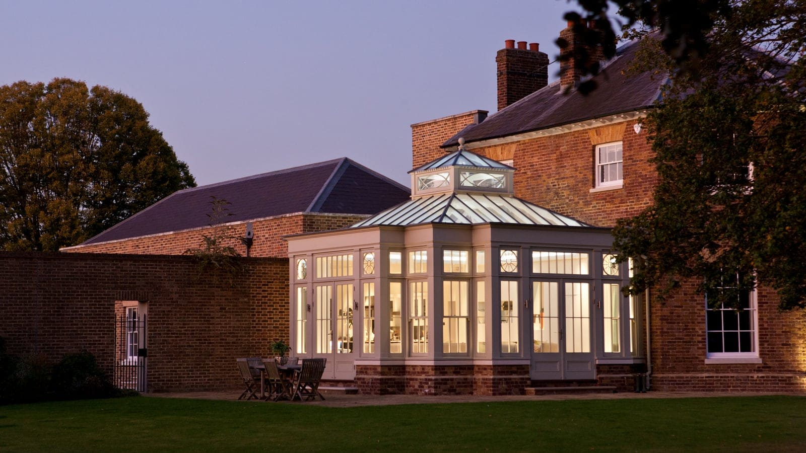 Long shot of beautiful orangery in the evening