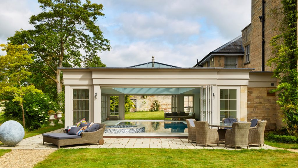 Glazed pool house with solar reflective glass and roof lantern
