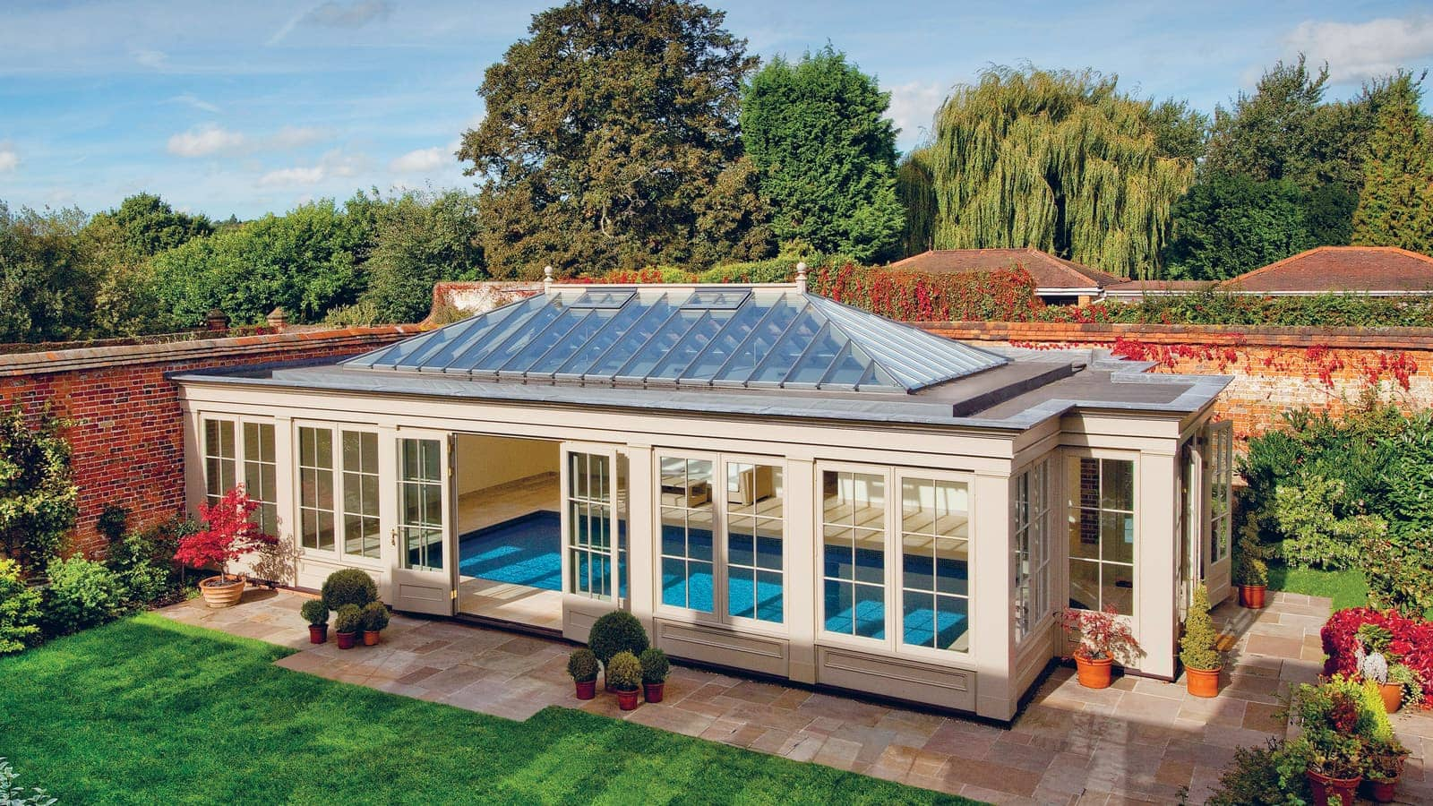 Striking pool house design sitting proudly within the impressive walled garden.